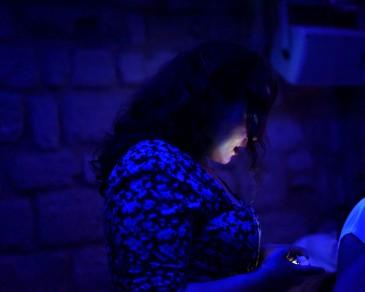 Paris –Lesbians check their phones, at the 3W
