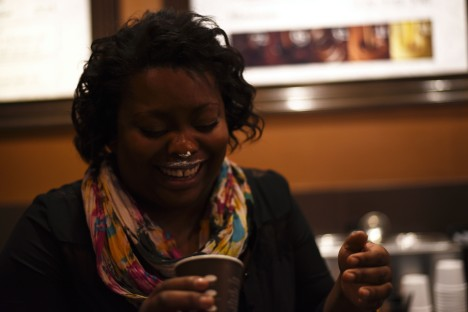"""Seattle –Cristeena's attempt at recreating a Got Milk? ad. We met at the coffee shop where she now works after holding an exec position in a big company. She's super open and friendly and we laugh when we notice her pattern of dating much older women. She also tells me she tends to be in biracial relationships, with more tomboyish girls, and those two elements have given rise to the only homophobia she's encountered here –Seattle being super open minded. She's from Texas originally and when I ask her to compare WA and TX she has this great line: now that gay marriage is legal in every state, the difference is in the people's attitudes when they see a gay wedding party: """"Here, it's 'Let's get shots!', in Texas it's 'You will get shot!'"""". She tells me being a lesbian has opened her eyes to so many things that she would be otherwise ignorant of."""