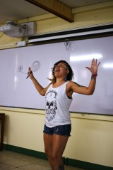 Rebeca explaining how songs can empower